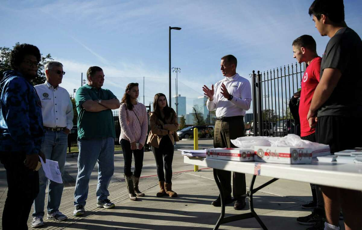 State Representative Jim Murphy, third from right, gives a speech to block walkers with the Harris County Republican Party before they head out for the morning Saturday, Dec. 5, 2015, in Houston. ( Michael Ciaglo / Houston Chronicle )