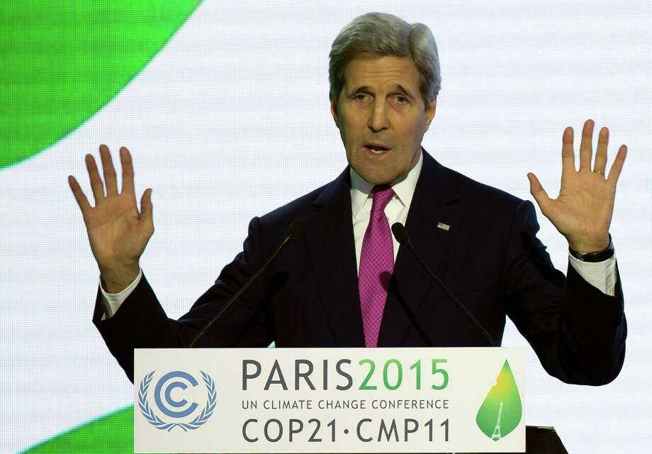 U.S Secretary of State John Kerry delivers his speech during a news conference at the COP21 Climate Conference in Le Bourget, north of Paris, France, Wednesday, Dec. 9 2015. Kerry is announcing that the United States will double its commitment to helping vulnerable nations adapt to climate change impacts such as increased extreme weather events. (Ian Langsdon, Pool via AP) Photo: Ian Langsdon, POOL / EPA POOL