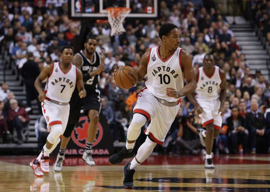 TORONTO, ON - DECEMBER 09:  DeMar DeRozan #10 of the Toronto Raptors dribbles the ball during an NBA game against the San Antonio Spurs at the Air Canada Centre on December 09, 2015 in Toronto, Ontario, Canada.  NOTE TO USER: User expressly acknowledges and agrees that, by downloading and or using this photograph, User is consenting to the terms and conditions of the Getty Images License Agreement. Photo: Vaughn Ridley, Getty Images / 2015 Getty Images