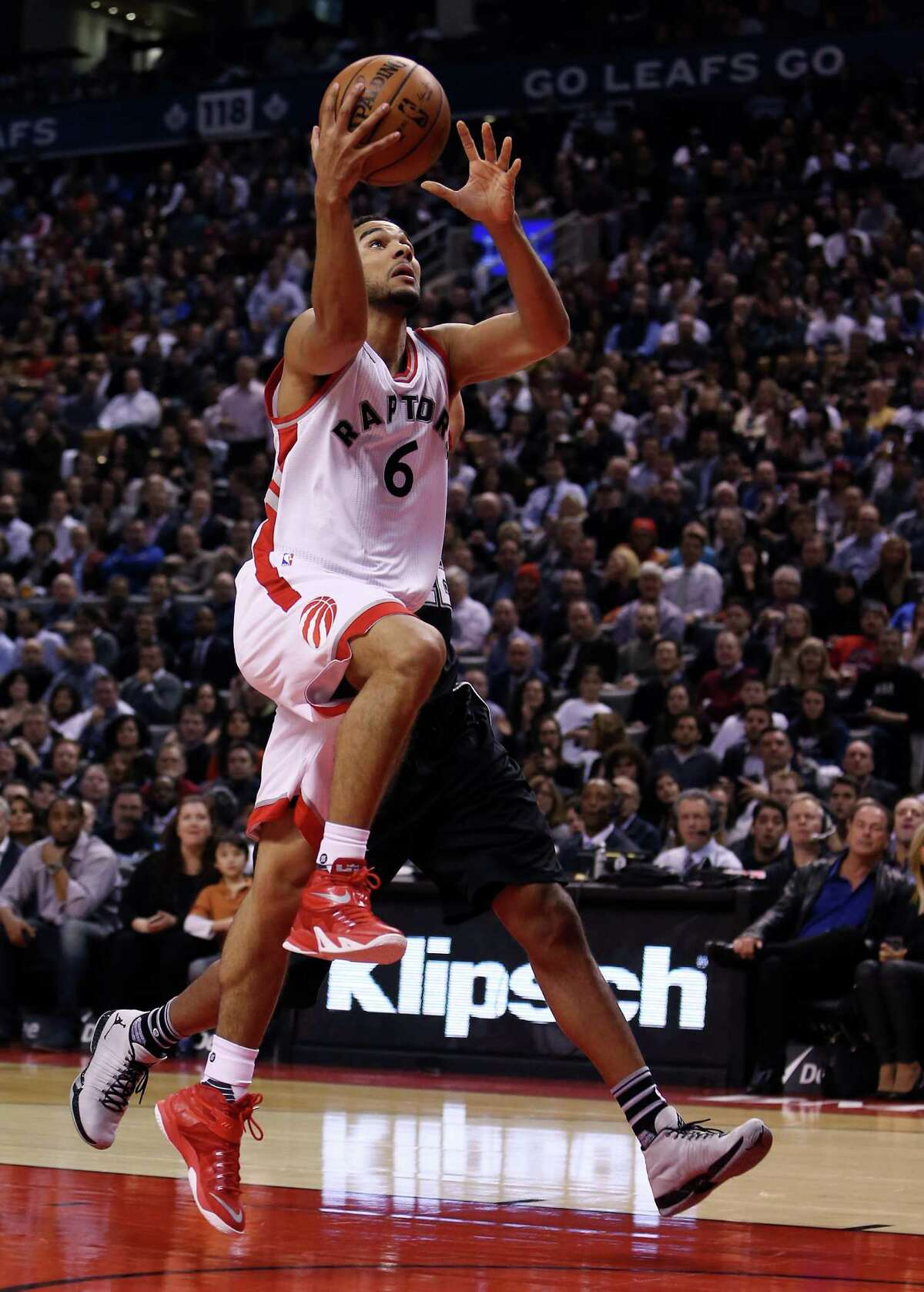 TORONTO, ON - DECEMBER 09: Cory Joseph #6 of the Toronto Raptors drives to the basket during an NBA game against the San Antonio Spurs at the Air Canada Centre on December 09, 2015 in Toronto, Ontario, Canada. NOTE TO USER: User expressly acknowledges and agrees that, by downloading and or using this photograph, User is consenting to the terms and conditions of the Getty Images License Agreement.