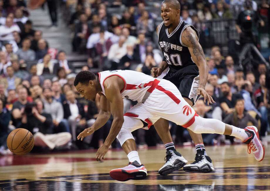 3600 x 2550~~$~~Toronto Raptors' guard Kyle Lowry (7) battles for the ball against San Antonio Spurs' forward David West (30) during first half of an NBA basketball game in Toronto, Wednesday, Dec. 9, 2015. (Nathan Denette/The Canadian Press via AP) MANDATORY CREDIT Photo: Nathan Denette, AP / The Canadian Press