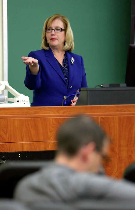 Kathy Funk-Baxter, UTSA vice president of business affairs and chairwoman of the UTSA Campus Carry Task Force, directs a presentation Wednesday afternoon, Dec. 9, 2015 at the university's downtown campus to update the university community on the development of its recommendations to implement Senate Bill 11, the campus carry law, which goes into effect Aug. 1, 2016. Photo: WILLIAM LUTHER, Staff / San Antonio Express-News / © 2015 San Antonio Express-News