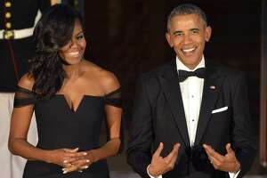 Obamas moving to Seattle?  Ex-president as mayor of Tacoma? The Onion jests! - Photo