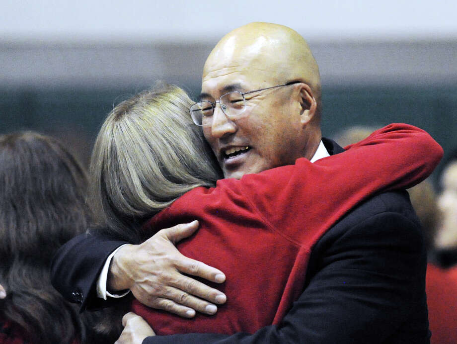 John Yoon, right, gets a hug from supporter Susan Delepine prior to the start of the appeal hearing. Photo: Bob Luckey Jr. / Hearst Connecticut Media / Greenwich Time