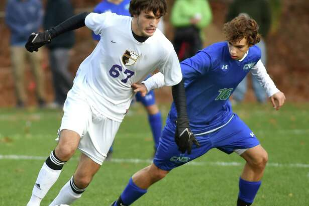 Ballston Spa's Connor DeFilippis, left, controls the ball as Cicero's Cameron Houser defends during in their Class AA regional soccer game on Saturday, Nov. 7, 2015, at Colonie High in Colonie, N.Y. (Cindy Schultz / Times Union)