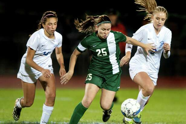 Shenendehowa's Meghan Cavanaugh, center, controls the ball as Saratoga's Elizabeth Maguire, left, and Brianna Dungate defend during their soccer game on Thursday, Oct. 15, 2015, at Saratoga Springs High in Saratoga Springs, N.Y. (Cindy Schultz / Times Union)