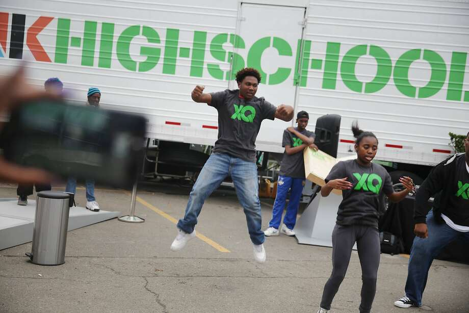 Future Shock members, a youth dance group with Culture Shock Oakland,  Jalen Hodge, 14, Envision High School; Chevelle Robinson, 16, Mission High School and Romeikus Moore, 16, City Arts & Technology High School, perform at the XQ roadshow on Wednesday, December 9,  2015 in Oakland, Calif. Photo: Lea Suzuki, The Chronicle