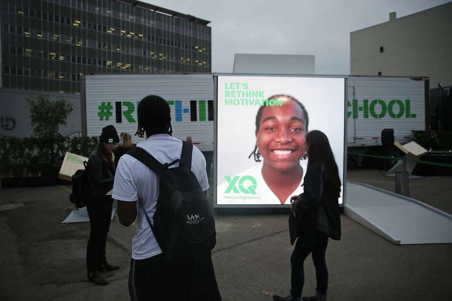 Amir Williams (foreground), junior Oakland High School, looks at his image projected on the XQ We Think booth during an XQ roadshow event at Broadway and 8th Street on Wednesday, December 9,  2015 in Oakland, Calif. Photo: Lea Suzuki, The Chronicle