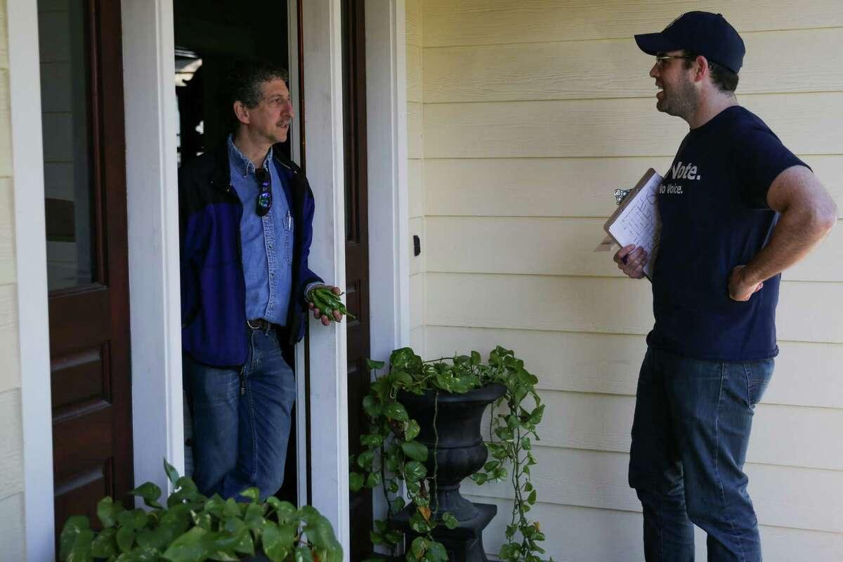 Battleground Texas volunteer TJ Hoffman, right, talks to Dan Gleitman at his home Saturday, Dec. 5, 2015, in Houston.