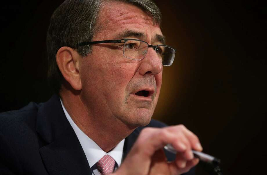 U.S. Defense Secretary Ash Carter, left, briefly sparred with Sen. John McCain during Wednesday's hearing about the use of U.S. ground troops in Iraq and Syria.  Photo: Alex Wong, Staff / 2015 Getty Images