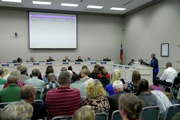 People listen during a special meeting called by the Judson ISD's board of trustees during which they discussed rescinding the naming of the district's new high school after former superintendent Willis Mackey on Wednesday, Dec. 9, 2015. The school will open next year. Mackey took a buyout and is still on the district's payroll.