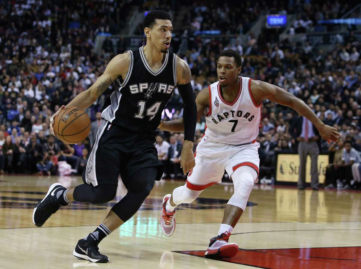 TORONTO, ON - DECEMBER 09: Danny Green #14 of the San Antonio Spurs dribbles past Kyle Lowry #7 of the Toronto Raptors during an NBA game at the Air Canada Centre on December 09, 2015 in Toronto, Ontario, Canada. NOTE TO USER: User expressly acknowledges and agrees that, by downloading and or using this photograph, User is consenting to the terms and conditions of the Getty Images License Agreement.