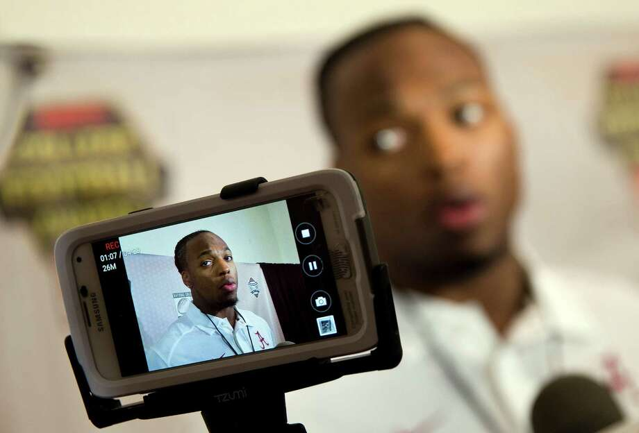 Alabama running back Derrick Henry spends time Wednesday in Atlanta conducting one of the many interviews he'll be giving this week as he prepares for tonight's College Football Awards Show and Saturday's Heisman Trophy presentation. Photo: John Bazemore, STF / AP