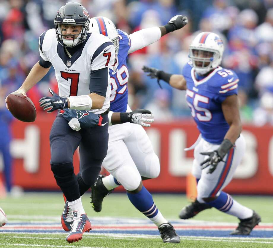 Houston Texans quarterback Brian Hoyer (7) is chased out of the pocket by Buffalo Bills defensive tackle Marcell Dareus (99) and  defensive end Jerry Hughes (55) during the second quarter of an NFL football game at Ralph Wilson Stadium on Sunday, Dec. 6, 2015, in Orchard Park, N.Y. ( Brett Coomer / Houston Chronicle ) Photo: Brett Coomer, Staff / © 2015  Houston Chronicle