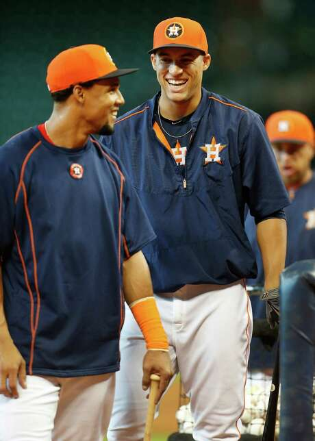 It's no laughing matter that Carlos Gomez, left, and George Springer have drawn trade interest from other teams, but the Astros are setting seriously high prices on the two outfielders. Photo: Karen Warren, Staff / © 2015 Houston Chronicle