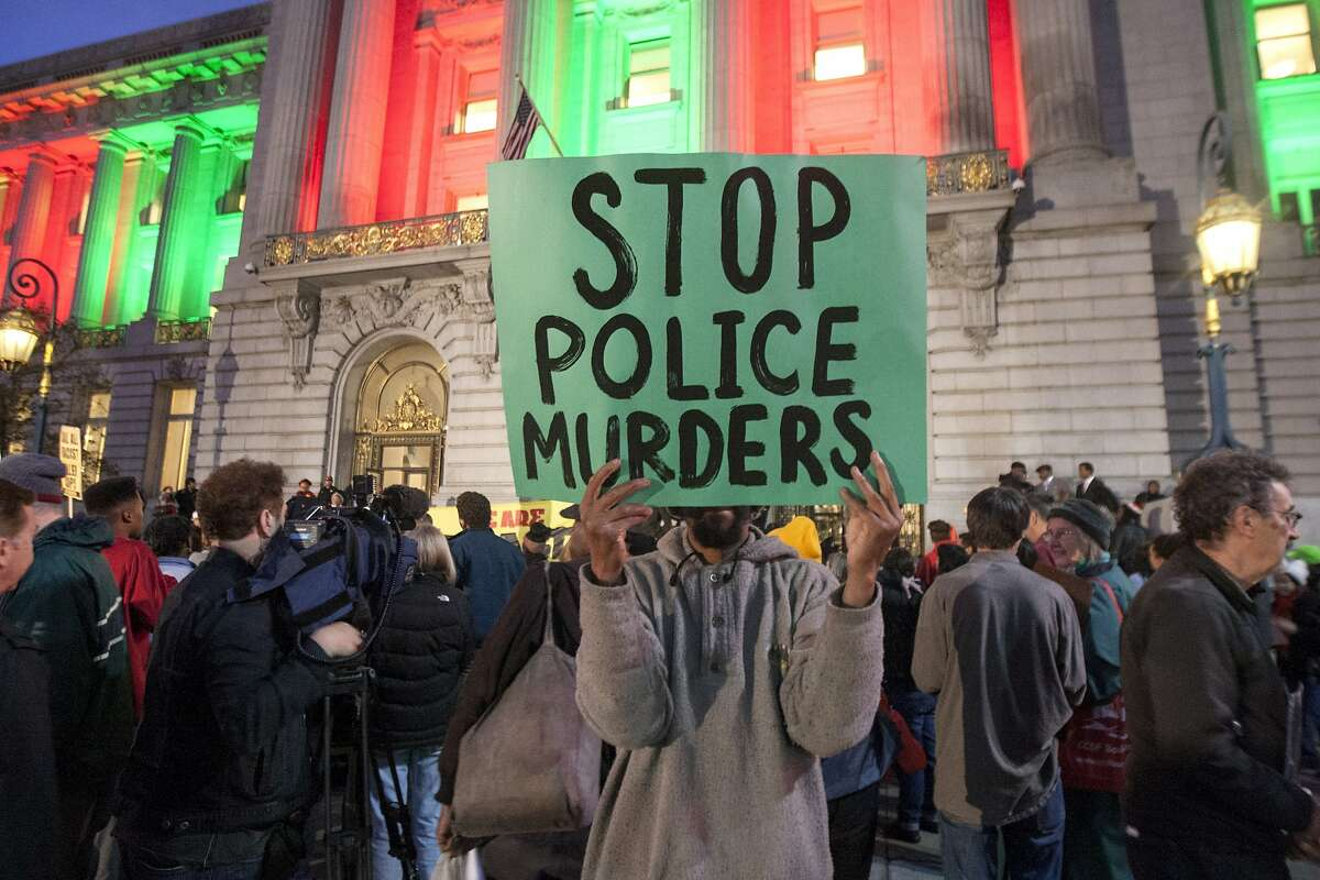 Hundreds of people protest outside San Francisco City Hall on Dec. 9.