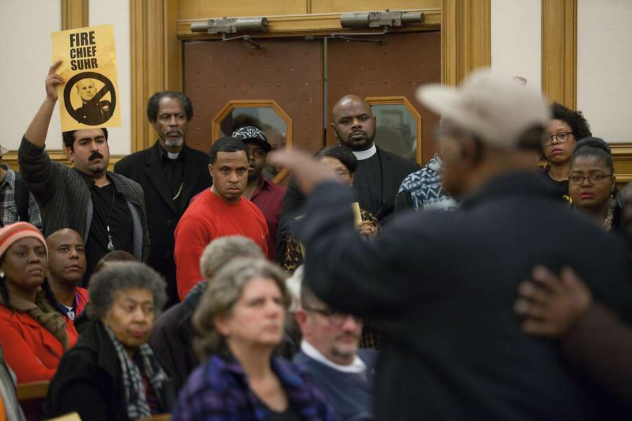Audience members listen during a raucous meeting at S.F. City Hall over the police shooting death of a black man in Bayview. Photo: Santiago Mejia, Special To The Chronicle