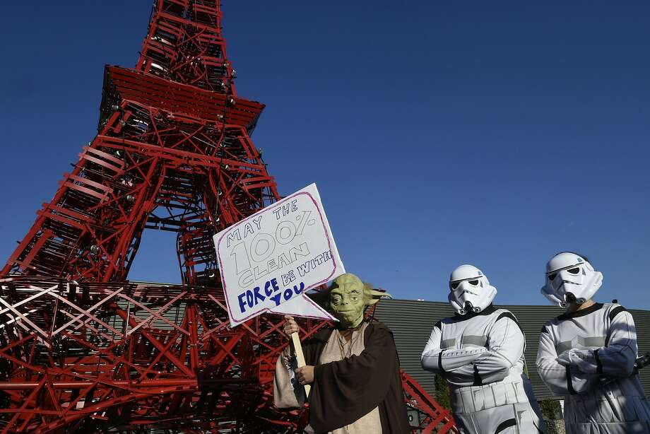 Avaaz activists dressed as Star Wars' Yoda and stormtroopers stand in front of a replica of the Eiffel Tower as they protest during the COP21 United Nations climate change conference in Le Bourget, outside Paris, on December 9, 2015. Photo: Dominique Faget, AFP / Getty Images