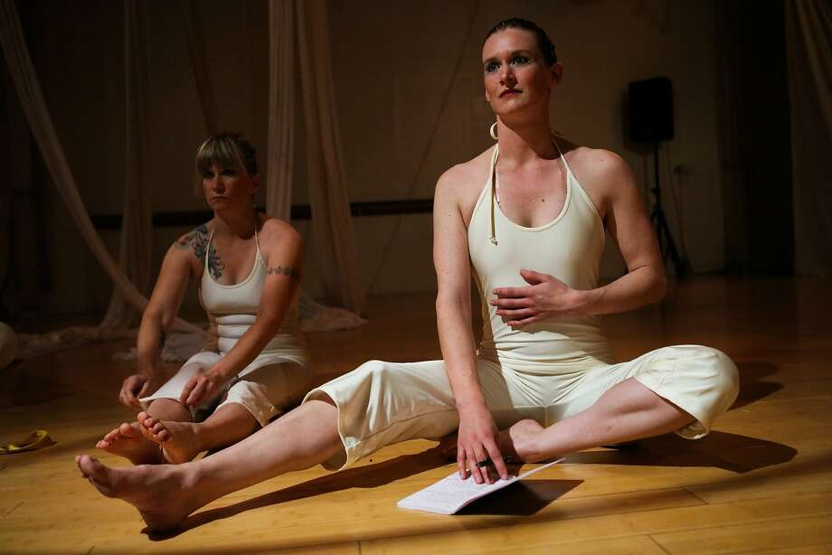 Helen Dickson (right) listens to instruction on posture for her aerial dance performance. Photo: Gabrielle Lurie, Special To The Chronicle