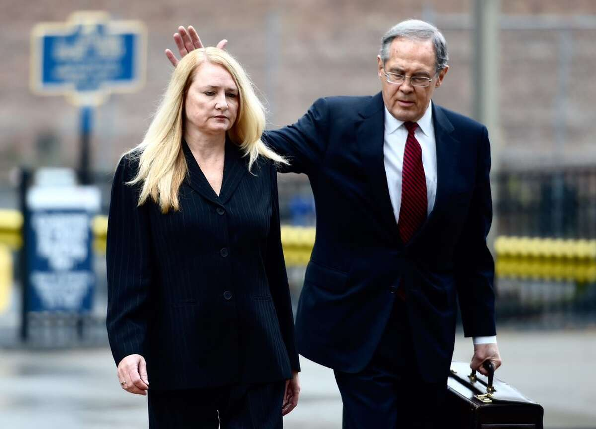 Former Halfmoon Town Supervisor Melinda Wormuth, left, and her attorney E. Stewart Jones, arrive at U.S. District Court for her sentencing Thursday morning on federal charges. (Skip Dickstein / Times Union)