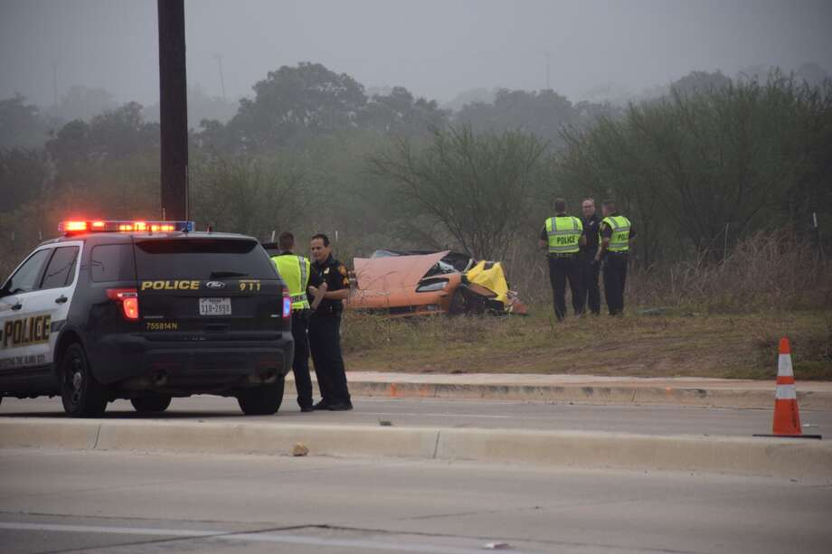 San Antonio police work the scene of a crash in the 18200 block of Bulverde Road after a man driving a Chevrolet Corvette was killed after slamming into a telephone pole on Dec. 10, 2015. Photo: Mark D. Wilson/San Antonio Express-News