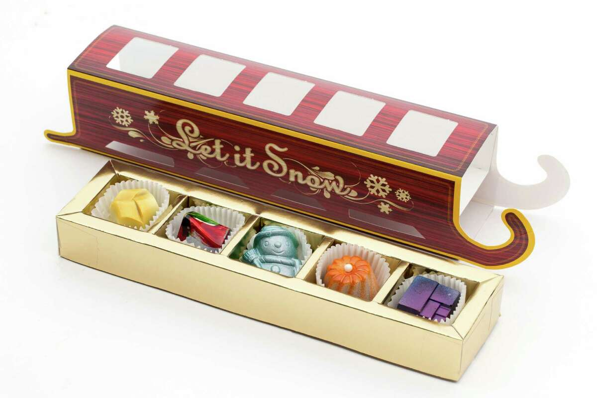 Houston luxury chocolate shop Cacao & Cardamom, 5000 Westheimer, has created several limited-edition flavors inspired by the holidays. Shown: Sleigh box of assorted chocolate bonbons.