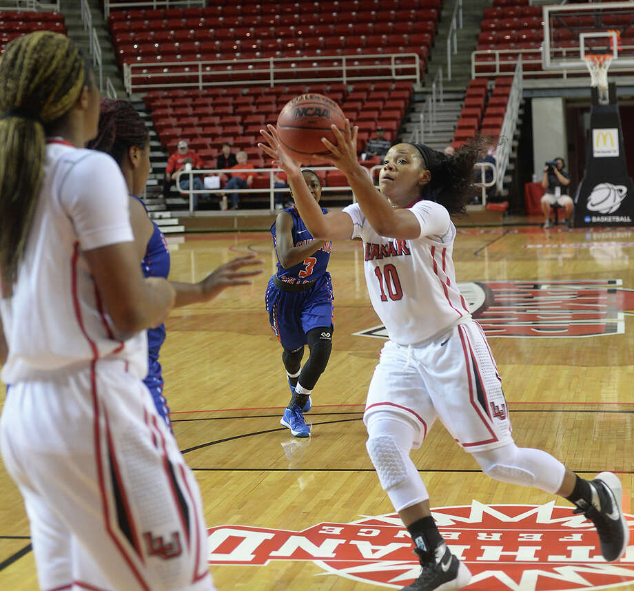 Lamar University's Chastadie Barrs gets hold of the ball as she moves into the paint against Louisiana College during the Lady Cardinals' home opener Thursday night at the Montagne Center. Photo taken Thursday, November 19, 2015 Kim Brent/The Enterprise Photo: Kim Brent / Beaumont Enterprise