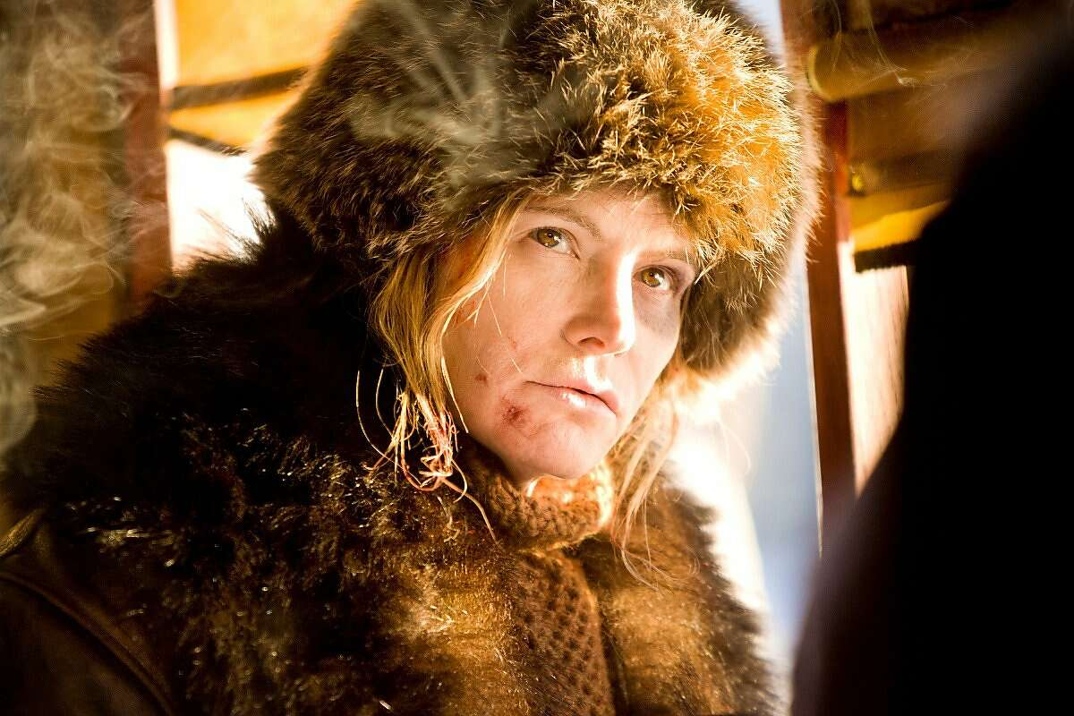 """This image released by The Weinstein Company shows Jennifer Jason Leigh in a scene from """"The Hateful Eight."""" Jason Leigh was nominated for a Golden Globe award for best supporting actress for her role in the film on Thursday, Dec. 10, 2015. The 73rd Annual Golden Globes will be held on Jan. 10, 2016. (Andrew Cooper/The Weinstein Company via AP)"""