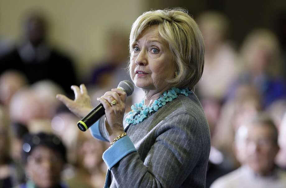 Hillary Rodham Clinton needs to convince voters that a woman is capable of being a strong commander in chief. Photo: Charlie Neibergall, Associated Press