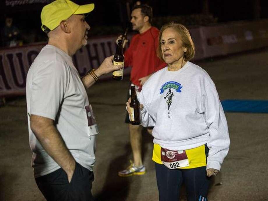 "Elvira ""Vera"" Montes, an 81-year-old woman from El Paso, became the oldest person to complete the FloTrack Beer Mile World Championships in Austin on Dec. 1, 2015, finishing at 20 minutes and 24.62 seconds. Photo: Caleb Kerr/El Paso Times"