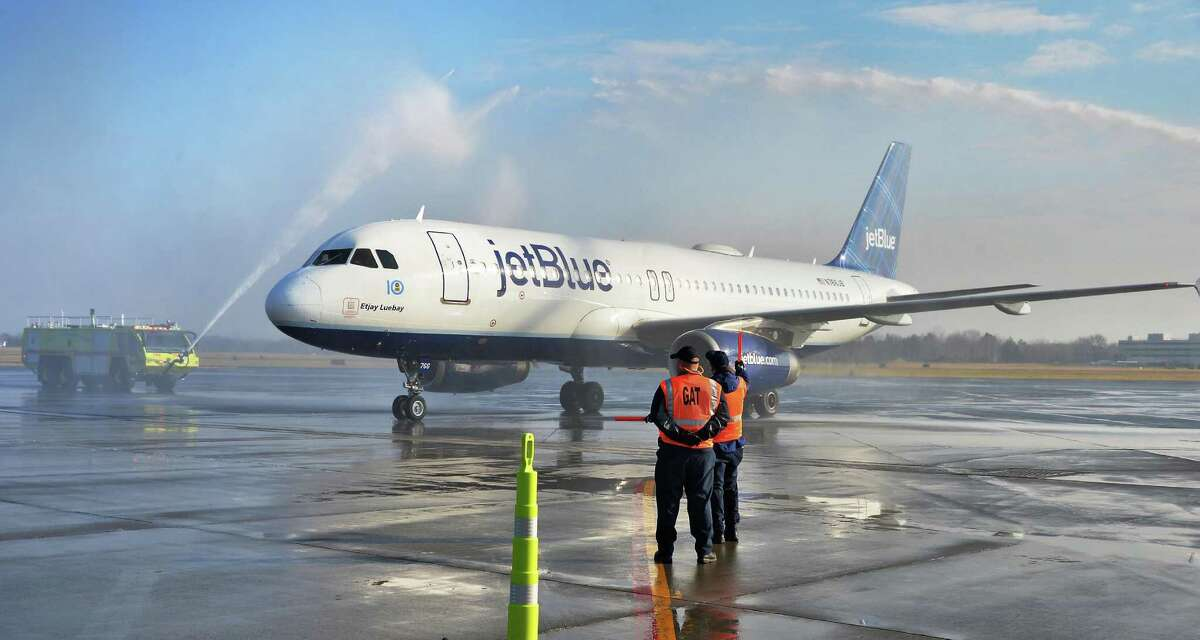 The first JetBlue flight into Albany International Airport is welcomed with a water cannon salute Thursday Dec. 10, 2015 in Colonie, NY. (John Carl D'Annibale / Times Union)