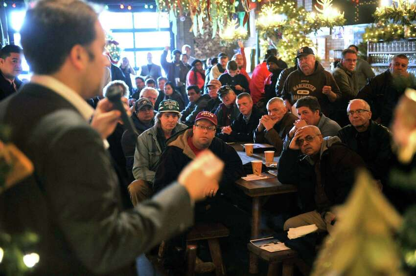 Potential Uber drivers listen to Josh Mohrer, general manager for Uber New York, as he answers questions during an information meeting held by the company at Wolff's Biergarten on Thursday, Dec. 10, 2015, in Albany, N.Y. (Paul Buckowski / Times Union)