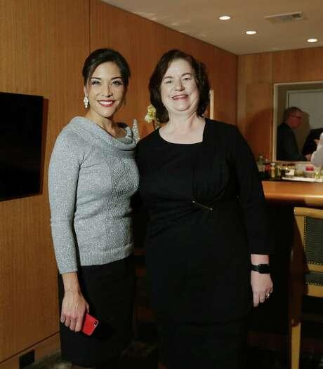 Lisa Foronda and Katy Caldwell at Holiday Schmooze benefiting Legacy Community Health. Photo: Jon Shapley, Houston Chronicle / © 2015  Houston Chronicle