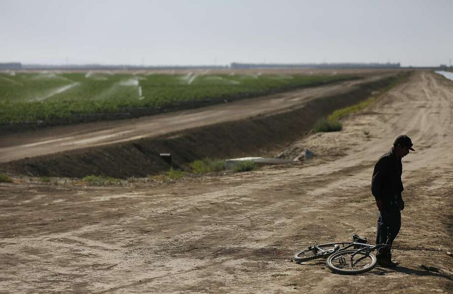 Martín Hernandez Mena, 50, prepares to take off his shoes before getting into an irrigation canal to cool off from the sweltering heat June 25, 2015, near the shantytown where he lives on a dried up canal bed on Westlands Water District land outside of Mendota, Calif. While it's too early to tell what the impact may be,La Niña,El Niño's sister phenomenon, may bring drier conditions to California in the fall. Scroll through this slideshow to see signs that a game-changer El Niño is coming this winter. Photo: Leah Millis, The Chronicle