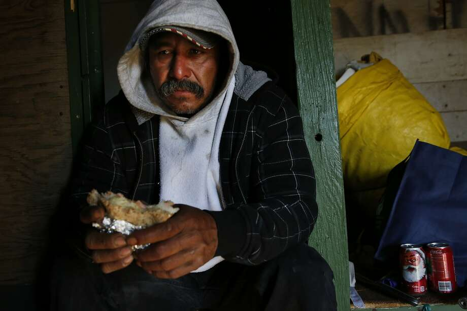 Mart'n Hernandez Mena, 50, becomes tearful as he eats his donated lunch as he waits for the police to show up to evict him on Nov. 20, 2015 outside of Mendota, Calif. Photo: Leah Millis, The Chronicle