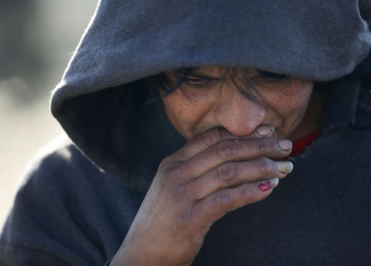 Maricela Montejano, 49, a resident of the shantytown tears up after she is evicted by the Fresno County Sheriff's Office.