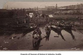 """	By the late 19th century, most Native Americans in the Seattle area had been moved to reservations. Many of these people made regular visits to Seattle to sell shellfish and souvenirs, or to look for odd jobs in the city. Each fall, many traveled through Seattle on their way to and from harvesting hops. They usually camped at Ballast Island or elsewhere along the waterfront. In this photo, a number of Native American canoes line the Seattle waterfront south of Yesler Street. It was taken sometime between 1890 and 1893 by the Seattle firm of Boyd & Braas."" -MOHAI. Photo courtesy MOHAI, Seattle Historical Society Collection, image number shs5118."