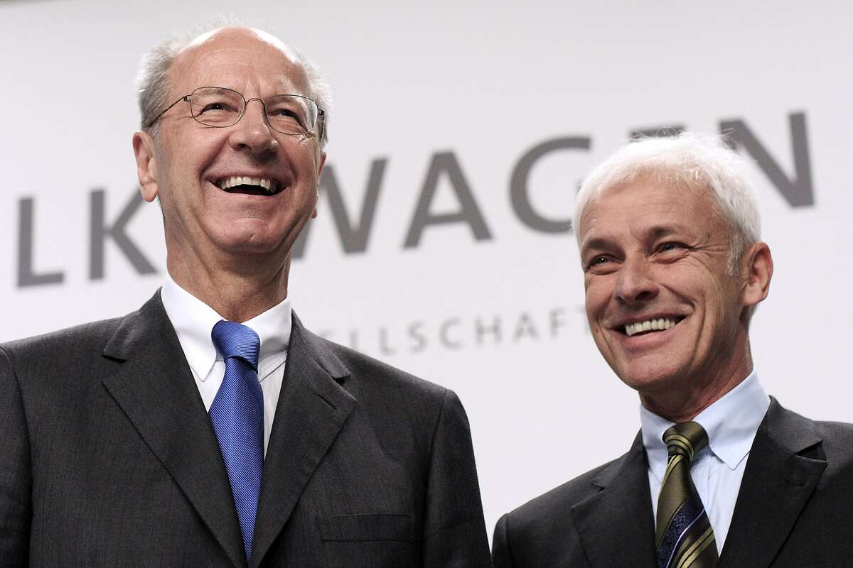 WOLFSBURG, GERMANY - DECEMBER 10: Hans Dieter Poetsch (L), Chairman of the Supervisory Board of Volkswagen AG, and Volkswagen Group Chairman Matthias Mueller (R), arrive to the press conference to announce the latest update in the company's handling of the engine emissions scandal on December 10, 2015 in Wolfsburg, Germany. Volkswagen is continuing to grapple with the consequences after it admitted installing software that cheats during emissions tests into 11 million of its diesel cars sold worldwide. (Photo by Carsten Koall/Getty Images)