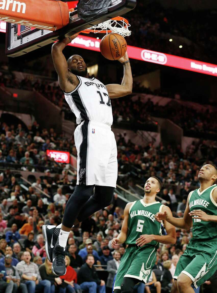 Spurs' Jonathon Simmons (17) gets a dunk against the Milwaukee Bucks at the AT&T Center on Wednesday, Dec. 2, 2015. Spurs defeated the Bucks, 95-70. (Kin Man Hui/San Antonio Express-News)