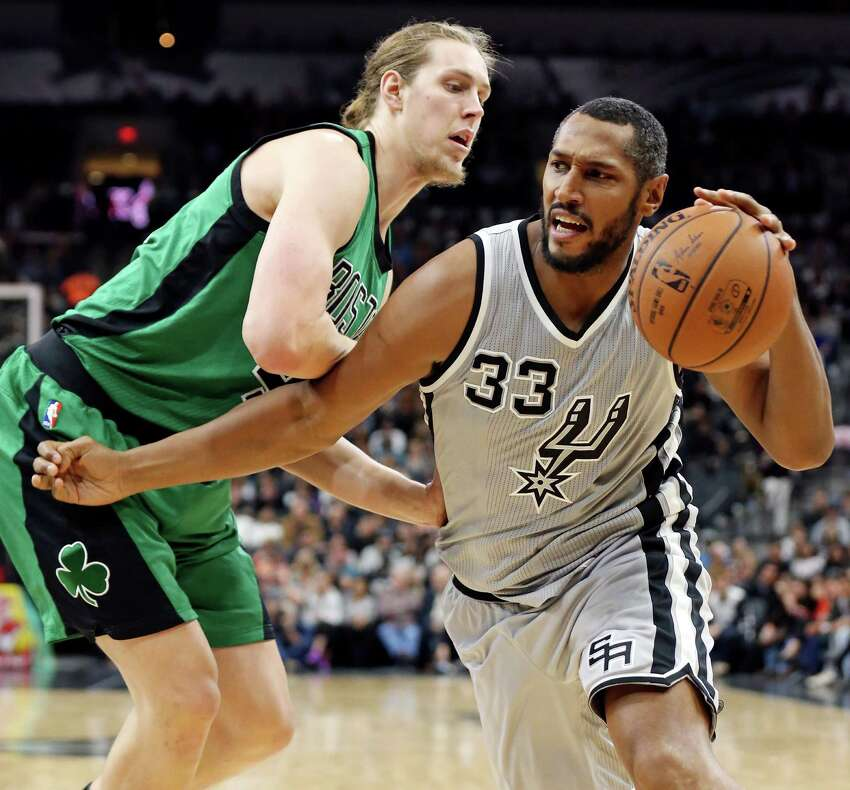 San Antonio Spurs' Boris Diaw looks for room around Boston Celtics' Kelly Olynyk during second half action Saturday Dec. 5, 2015 at the AT&T Center. The Spurs won 108-105.
