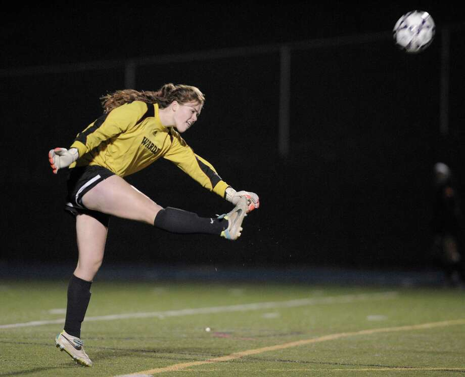 Warde girls' soccer goalkeeper Mollie Kerrigan, shown here in the Class LL tournament, will continue her career at the University of Connecticut, one of five players from that team that will go on to play in college. Photo: H John Voorhees III / H John Voorhees III / The News-Times