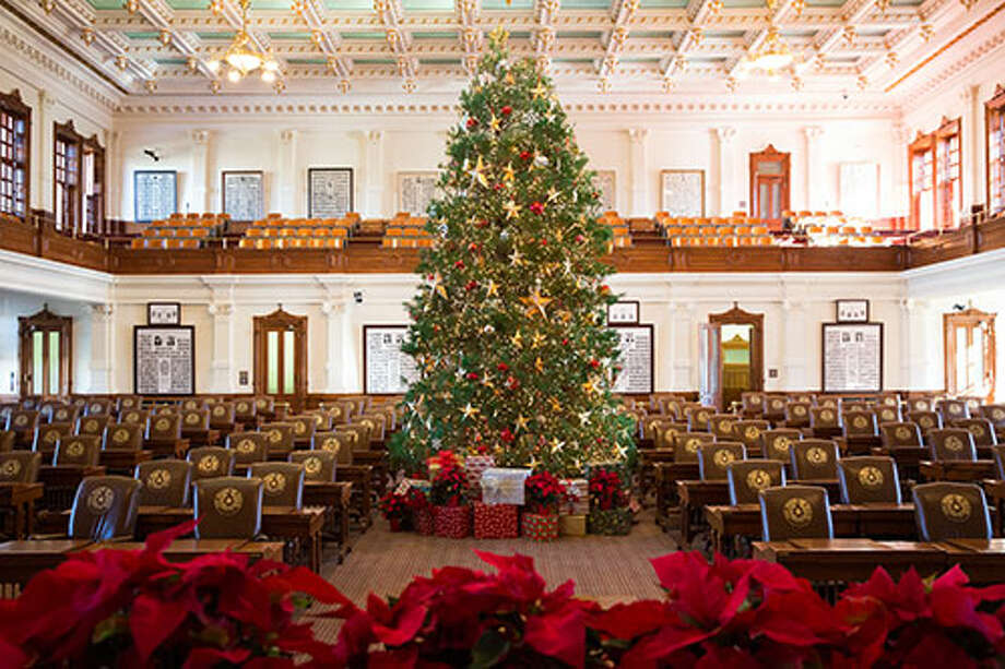 A Christmas tree is erected in the Texas House in December 2015. A tree has been featured in the chamber every year since at least 2010. Photo: Tanya Fleming,  Kyle Woods And Steve Moakley(Texas House Of Representatives)