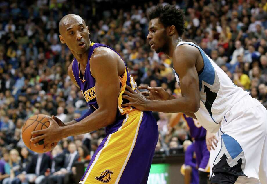 Los Angeles Lakers forward Kobe Bryant looks to drive against Minnesota Timberwolves guard Andrew Wiggins during the second half. Photo: Ann Heisenfelt /Associated Press / FR13069 AP