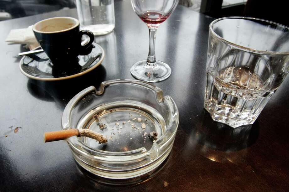 A cigarette burns out in an ashtray. (AP Photo/Francois Mori) Photo: Francois Mori, STF / AP