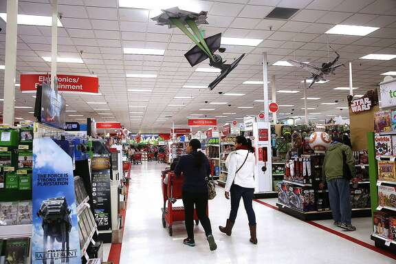 Ads surround an aisle featuring Star Wars merchandise  at Target in Colma, California, on Thursday, December 10, 2015.