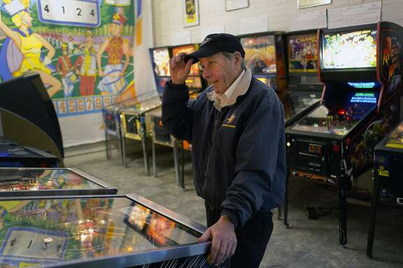 """Gary Bargman, 64, a regular at the Pacific Pinball Museum in Alameda, plays a favorite pinball game on December 9, 2015 in Alameda, Calif. Bargman has been frequenting the museum a few times a week for the past 8-9 years. """"Pinball for life is my motto,"""" he says."""