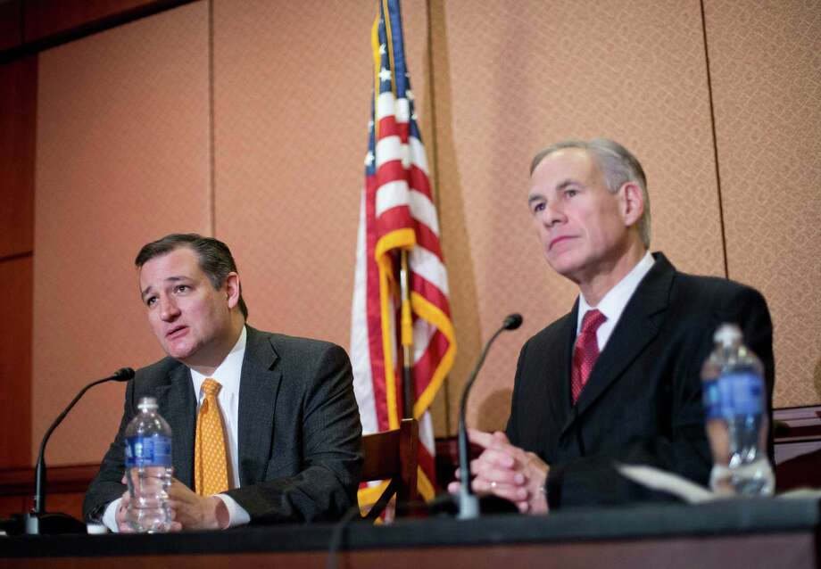 Republican presidential candidate Sen. Ted Cruz, R-Texas, left, and Texas Gov. Greg Abbott, right, speak about the resettlement of Syrian refugees in the U.S., during their joint news conference on Capitol Hill in Washington, Tuesday, Dec. 8, 2015. (AP Photo/Pablo Martinez Monsivais) Photo: Pablo Martinez Monsivais, STF / AP