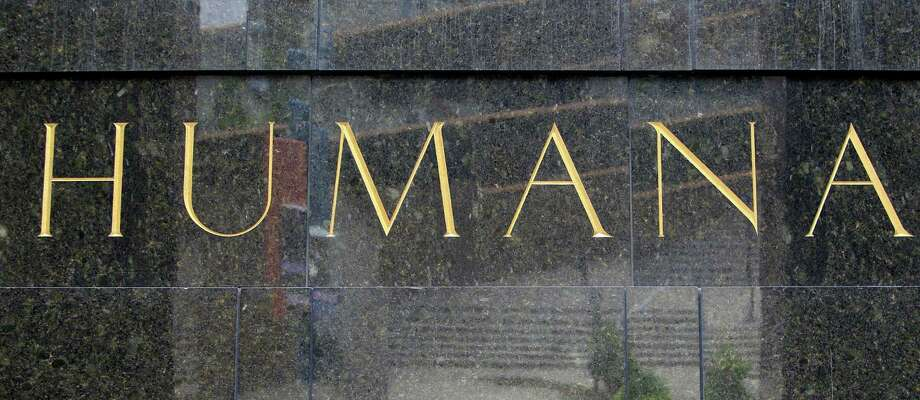 FILE - This Aug. 8, 2011 file photo shows the entrance to the Humana building in Louisville, Ky. Health insurer Aetna Inc. has made a deal to buy competitor Humana Inc. in a $37 billion deal the companies say would create the second-largest managed care company, it was announced Friday, July 3, 2014.  (AP Photo/Ed Reinke, File) Photo: Ed Reinke, STF / AP