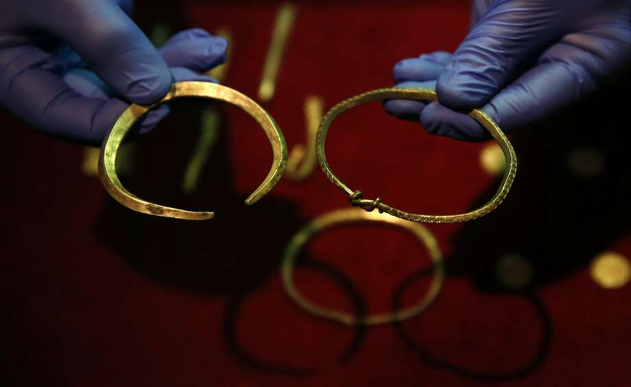 A close up of some of the jewelry and ingots of a significant Viking hoard found near Watlington, in Oxfordshire, England, as they are displayed at the British Museum in London. Photo: Alastair Grant, Associated Press