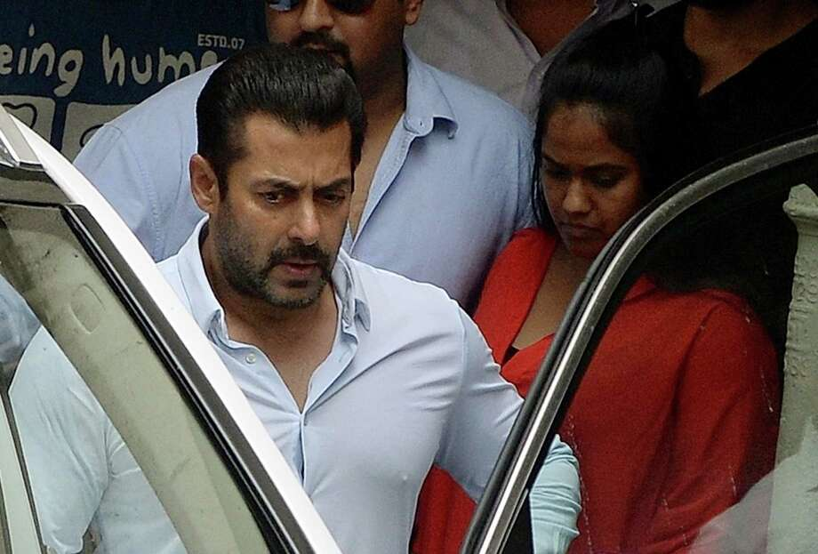 (FILES) In this photograph taken on May 8, 2015, Indian Bollywood film actor Salman Khan leaves his home to appear at a Sessions Court in Mumbai.   An Indian court December 10, 2015 cleared Bollywood superstar Salman Khan of killing a homeless man in a hit-and-run crash 13 years ago, acquitting him of all charges after he filed an appeal against his conviction.  AFP PHOTO/ PUNIT PARANJPE / FILESPUNIT PARANJPE/AFP/Getty Images Photo: PUNIT PARANJPE, Stringer / AFP